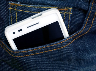 Close up of smart phone in pocket jeans