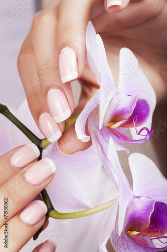 Poster Beautiful woman's nails with french manicure.