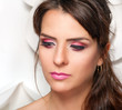 Fashion portrait of beautiful woman with rose makeup