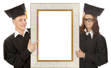 Graduate standing behind frame