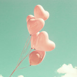 Bunch of pink heart-shaped balloons