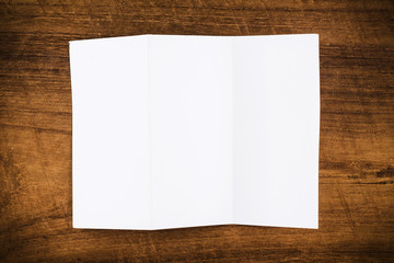 Fold paper on wood background