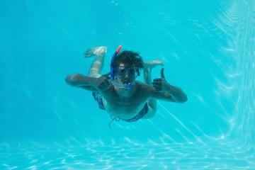 Man underwater gesturing thumbs up
