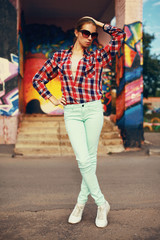 Colorful fashion photo pretty stylish woman posing in the city,