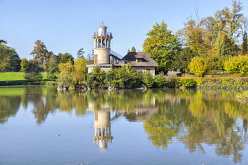 The Marlborough Tower reflecting in pond in Marie-Antoinette's e