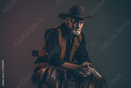 Cigarette smoking old rough western cowboy with gray beard and b - 71983845