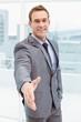 canvas print picture - Portrait of smart businessman offering handshake