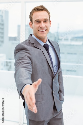 canvas print picture Portrait of smart businessman offering handshake