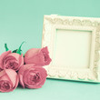 Vintage photo frame and red roses - 71986076
