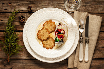 Vintage christmas table - white plate with ginger cookies