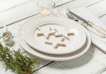 Christmas table - elegant white plate with cookies