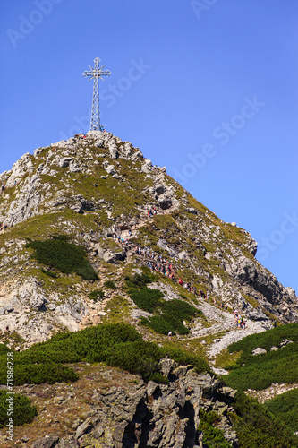Giewont - Famous mountain in Polish Tatras with a cross on top. - 71986228