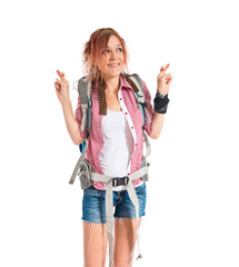 backpacker with her fingers crossing over white background