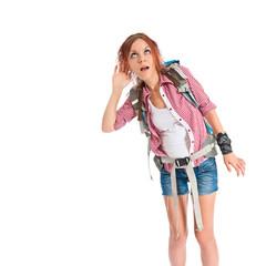 backpacker listening over isolated white background