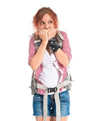 Frightened backpacker over isolated white background