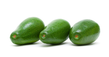 three ripe avocado isolated on white background