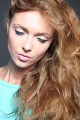 Beautiful redhead woman posing at the studio