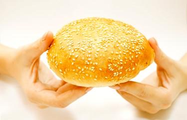 Wheaten roll in hands