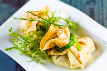 pancakes with meat decorated green onions