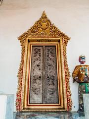 Golden door frame with 2 door panels pearl decorated.