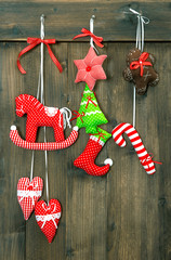 christmas decoration handmade toys hanging over wooden backgroun