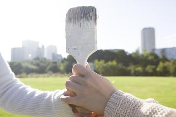 Hand holding the brush