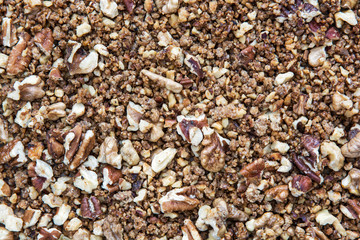 Background of cracked pecans and walnuts with caramelized brown