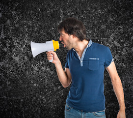 Man shouting over textured background