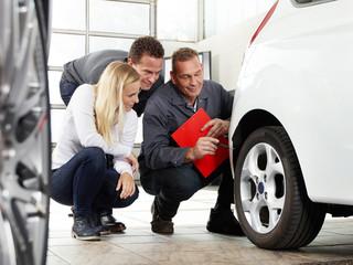 Mechanic with customers