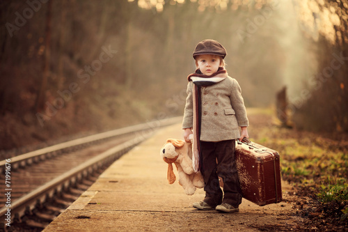 Adorable boy on a railway station, waiting for the train - 71991676