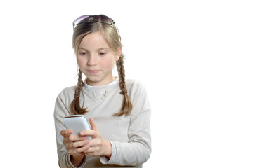 a young girl playing with a mobile phone