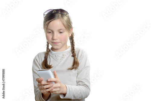canvas print picture a young girl playing with a mobile phone