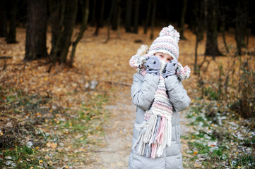 Winter portrait of child girl in warm clothes