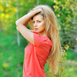 Outdoor portrait of young sexyl woman with chic hair