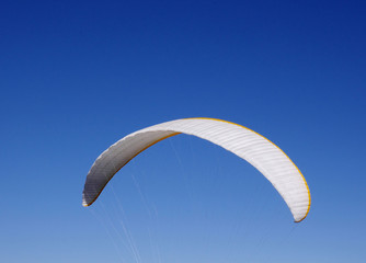 White paraglider  in the sky