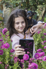 Child shooting flowers with tablet