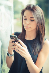 young beautiful brunette straight hair woman using smartphone