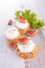 bread with cheese and fresh fig