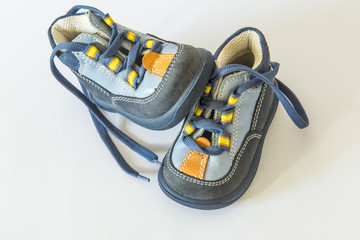seasonal children's shoes isolated over the white