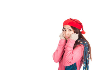 Asian girl with red christmas hat feel cold