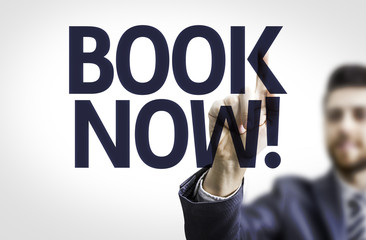 Business man pointing the text: Book Now