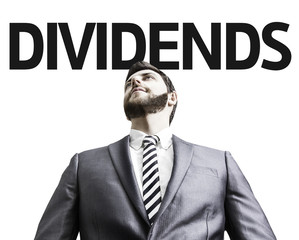 Business man with the text Dividends in a concept image