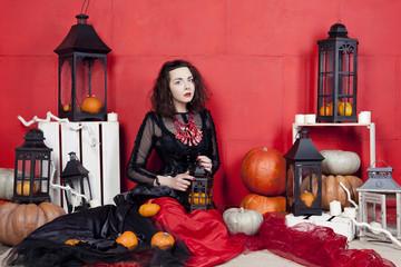 Young woman in photo studio on Halloween