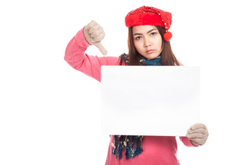 Asian girl with red christmas hat show blank sign and thumbs dow