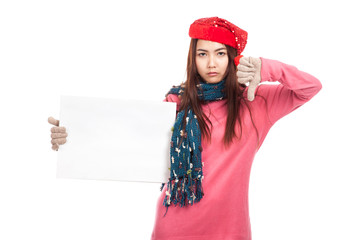 Asian girl with red christmas hat show thumbs down and  blank si