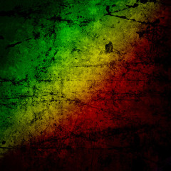 Red, yellow, green rasta flag on grunge textured concrete  wall