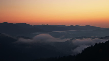 Dawn Mist in the Forested Mountains. Time Lapse