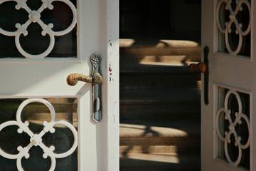Close up of the iron door handle on the old wooden door