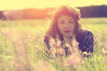 Lonely woman relax on grass