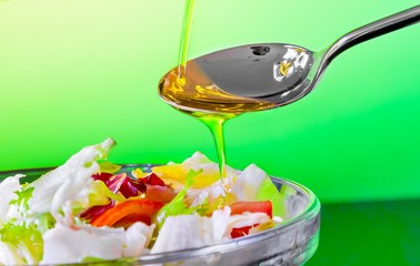 spoon with olive oil on italian fresh salad